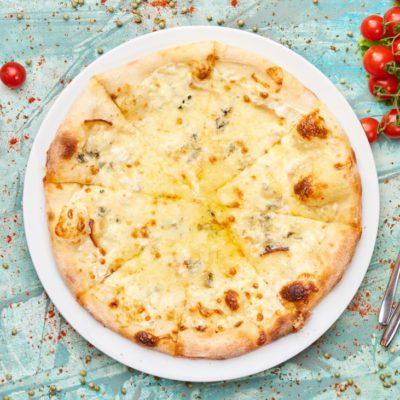 PIZZA QUATRO FORMAGI - Meadows Restaurant